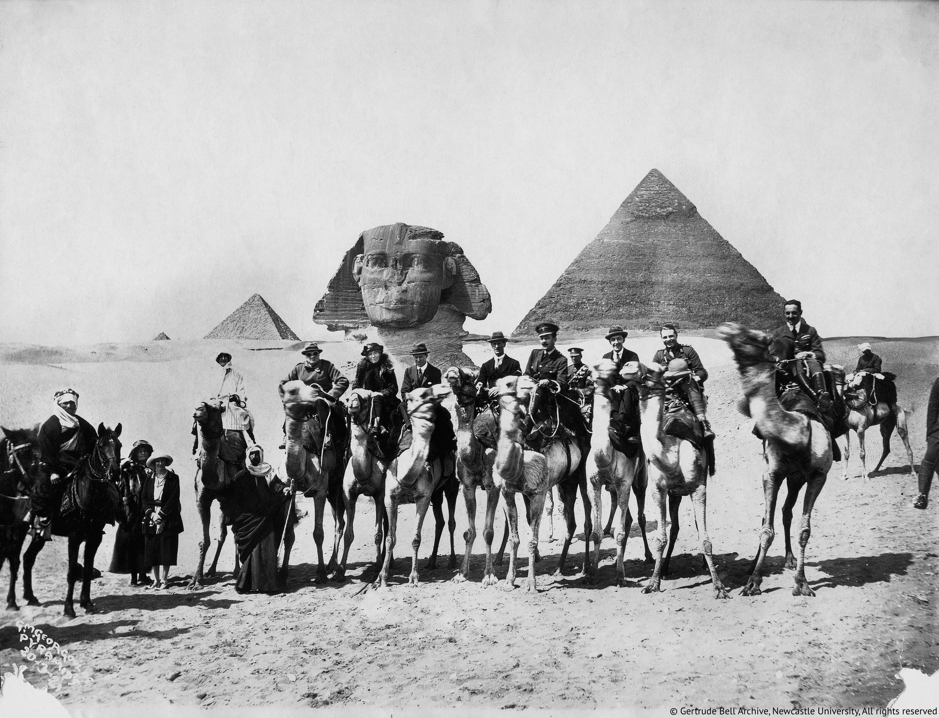 Gertrude Bell, seated between Winston Churchill and T.E.Lawrence, Cairo Conference, 1921_resize-imp